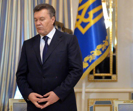 Janoekovitsj vorige week bij de ondertekening van een akkoord met de parlementaire oppositie.