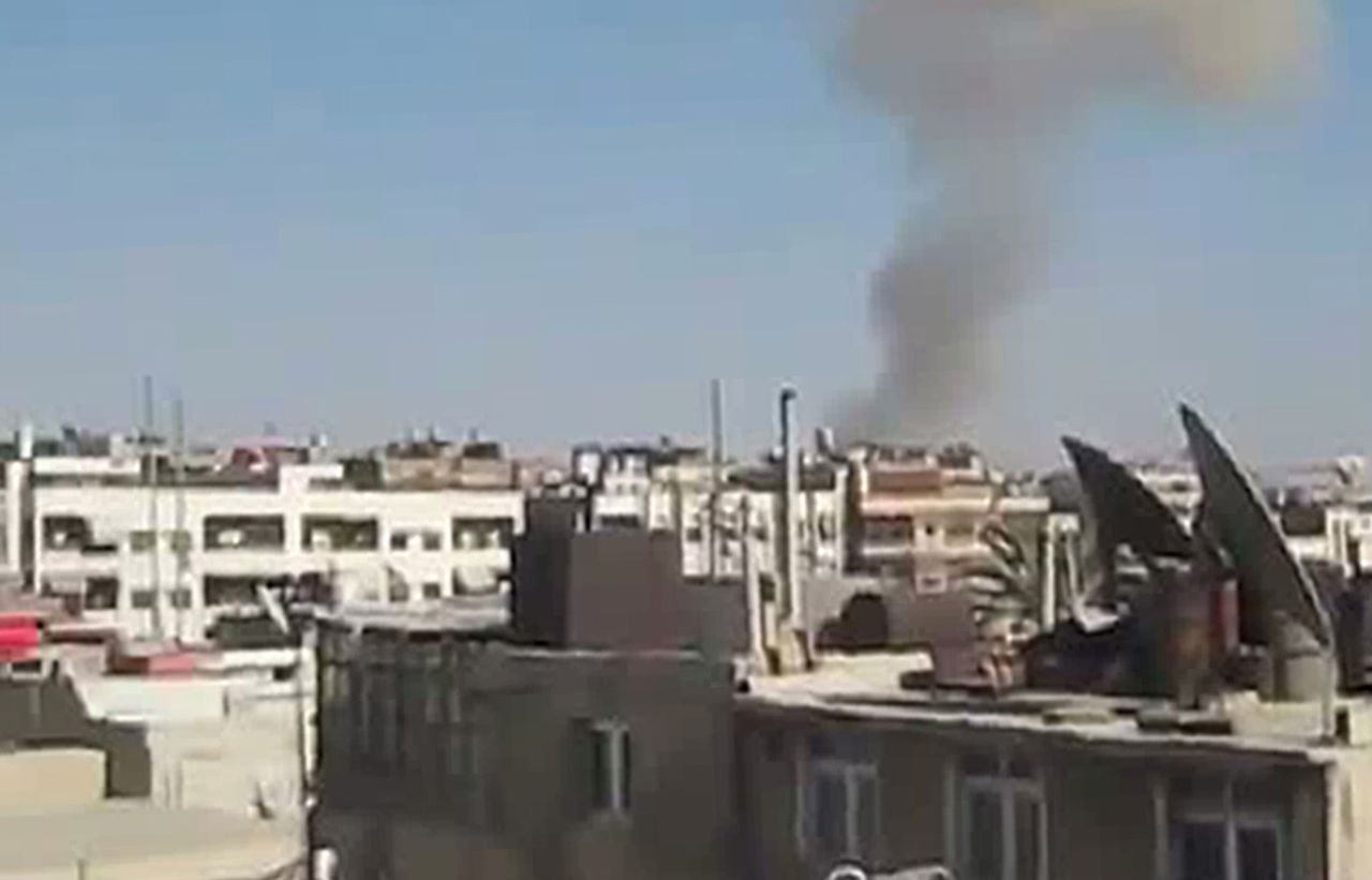 """An image grab taken from a video uploaded on YouTube on July 17, 2012, shows smoke billowing from buildings in the al-Midan neighbourhood of the Syrian capital, Damascus, as forces loyal to the government regime allegedly shelled the area. Regime forces and members of the Free Syrian Army (FSA) clashed at dawn on July 17, in the al-Midan and Zahira districts of Damascus as well as at Assali south of the city, the Local Coordination Committees said. AFP PHOTO/YOUTUBE == RESTRICTED TO EDITORIAL USE - MANDATORY CREDIT """"AFP PHOTO / HO / YOUTUBE"""" - NO MARKETING NO ADVERTISING CAMPAIGNS - DISTRIBUTED AS A SERVICE TO CLIENTS - AFP IS USING PICTURES FROM ALTERNATIVE SOURCES AS IT WAS NOT AUTHORISED TO COVER THIS EVENT, THEREFORE IT IS NOT RESPONSIBLE FOR ANY DIGITAL ALTERATIONS TO THE PICTURE'S EDITORIAL CONTENT, DATE AND LOCATION WHICH CANNOT BE INDEPENDENTLY VERIFIED =="""