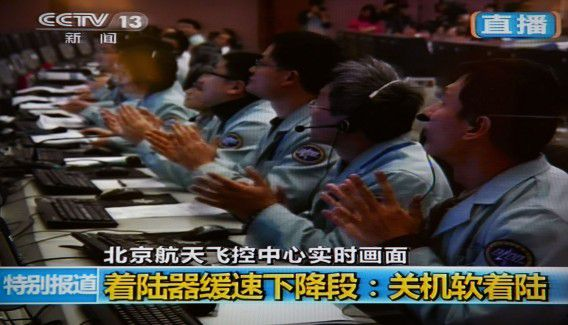 """This screen grab taken from CCTV live broadcasting footage shows scientists celebrating at the control centre in Beijing after China's first lunar rover landed on the moon on December 14, 2013. A space module carrying China's first lunar rover landed on the moon December 14, state television showed, a major step for the emerging superpower's ambitious space programme. A computer generated image of the spacecraft was shown landing to the applause of scientists at a Beijing control centre, state broadcaster China Central Television (CCTV) showed, 12 days after Chang'e-3 blasted off on a Long March-3B carrier rocket. AFP PHOTO / CCTV ----EDITORS NOTE---- RESTRICTED TO EDITORIAL USE - MANDATORY CREDIT """"AFP PHOTO / CCTV - NO MARKETING NO ADVERTISING CAMPAIGNS - DISTRIBUTED AS A SERVICE TO CLIENTS"""