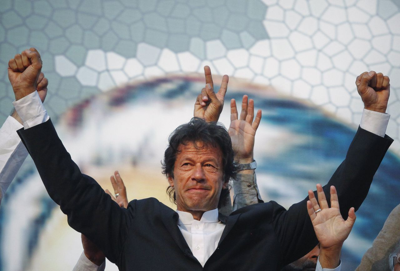 Imran Khan, Pakistani cricketer turned politician, gestures after arriving to lead the Pakistan Tehreek-e- Insaf (PTI) rally in Lahore October 30, 2011. Khan, chairman of the PTI, on Sunday said the biggest problem facing Pakistan is corruption which the PTI will strive to eradicate and install honest officers in key positions, local media reported. REUTERS/Mohsin Raza (PAKISTAN - Tags: POLITICS CIVIL UNREST)