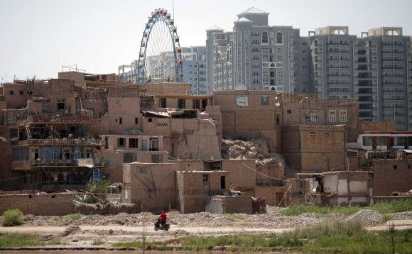 The old district of Kashgar is seen in Xinjiang province August 4, 2011. The 'renovations' of the old Kashgar center is a prime example of China's modernizing campaigns in minorities ethnic regions. However many city residents have mixed feelings about the disappearance of the narrow streets and adobe homes once hailed as the best surviving example of Central Asian architecture. REUTERS/Carlos Barria (CHINA - Tags: POLITICS BUSINESS SOCIETY)
