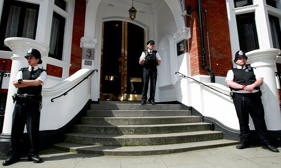 Caption: Police stand guard outside the Ecuadorian Embassy, London, Wednesday June 20, 2012. WikiLeaks chief Julian Assange has made a run for the Ecuadorean Embassy in London, seeking asylum in a long shot move that, if successful, would place him in a small, friendly South American country rather than in Sweden facing questioning about alleged sex crimes. Tuesday's unexpected caper has added a new and bizarre twist to Assange's increasingly desperate bid to avoid extradition to Scandinavia. (AP Photo/Tim Hales)