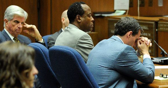 Caption: (L-R): Defense attorney J. Michael Flanagan, Dr. Conrad Murray and defense attorney Ed Chernoff listen during rebuttal in the prosecution's closing arguments during the final stage of Conrad Murray's defense in his involuntary manslaughter trial in the death of singer Michael Jackson at the Los Angeles Superior Court on November 3, 2011 in Los Angeles, California. Murray, who has pleaded not guilty, faces four years in prison and the loss of his medical licenses if convicted of involuntary manslaughter in Jackson's death. AFP PHOTO / POOL / Kevork Djansezian