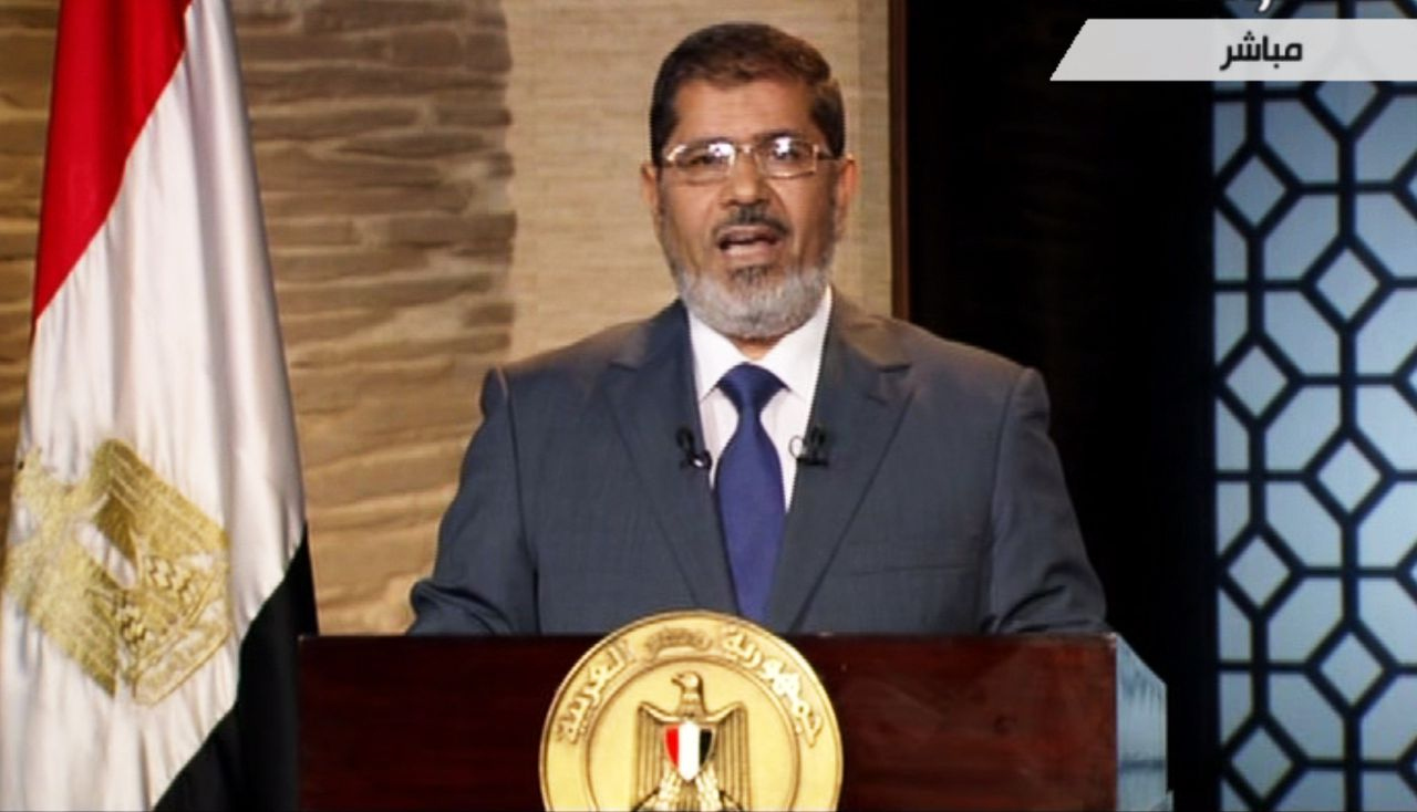 """In this image taken from Egypt State TV, newly-elect President Mohammed Morsi delivers a speech in Cairo, Egypt, Sunday, June 24, 2012. Morsi has called for unity and said he carries """"a message of peace"""" to the world. In his first televised speech on state TV, Morsi pledged Sunday to preserve Egypt's international accords, a reference to the peace deal with Israel. (AP Photo/Egypt State TV) MANDATORY CREDIT"""