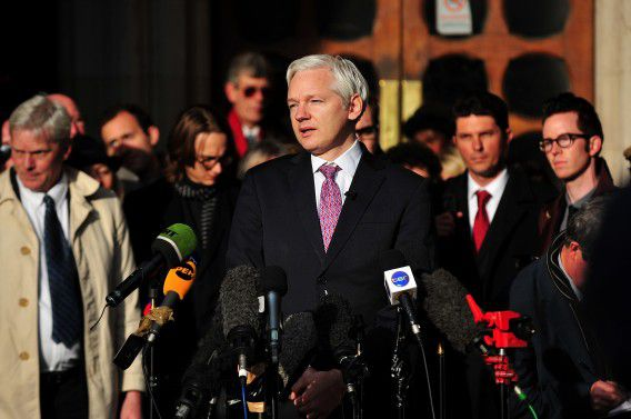 WikiLeaks founder Julian Assange (L) speaks to the media after leaving the High Court in London on December 5, 2011 where he attended a ruling in his long-running fight against extradition to Sweden. Assange was on December 5 granted permission to apply to England's highest court in a final attempt to block his extradition to Sweden over rape allegations. AFP PHOTO / BEN STANSALL