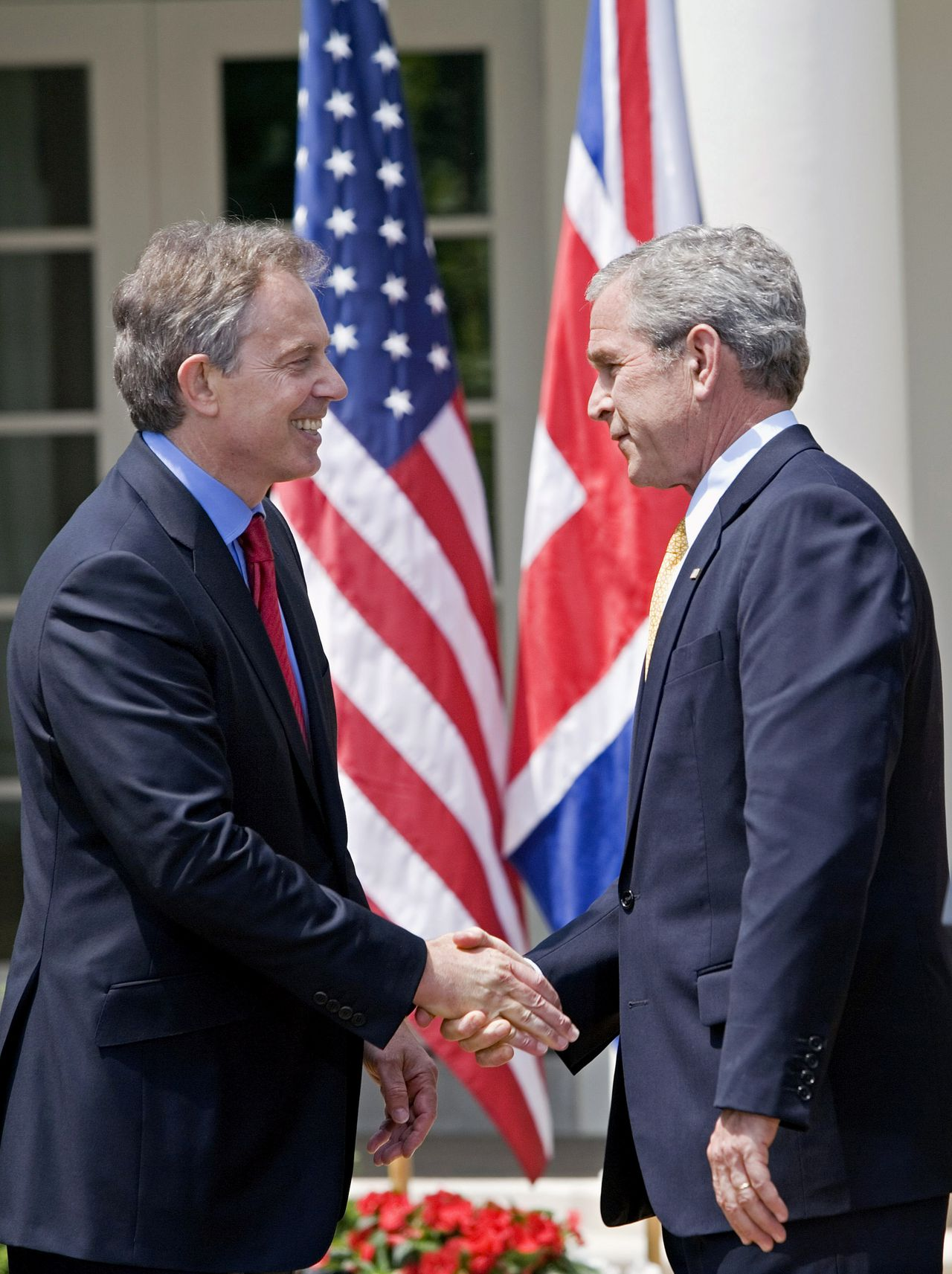 British Prime Minister Tony Blair, left, and U.S. President George W. Bush shake hands after a joint news conference in the Rose Garden of the White House, May 17, 2007, in Washington D.C. Bush and Blair said the U.S.-U.K. alliance in Iraq and cooperation on other global issues won't be diminished once Blair leaves office. Photographer: Brendan Smialowski/Bloomberg News