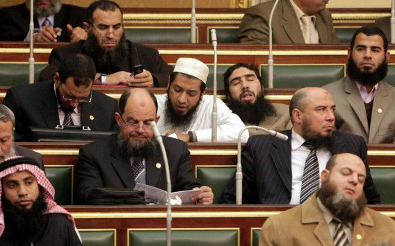 FILE - In this Monday, Jan. 23, 2012 file photo, Salafi lawmakers attend the first Egyptian parliament session after the revolution that ousted former President Hosni Mubarak, in Cairo, Egypt. The uprisings that first began in Tunisia in December 2010 did bring down dictators in Tunisia, Yemen, Libya and Egypt. But now Islamists and liberals wrangle over power, with the former mostly on top, democracy is far from certain, and economies are crumbling. (AP Photo/Asmaa Waguih, Pool, File)
