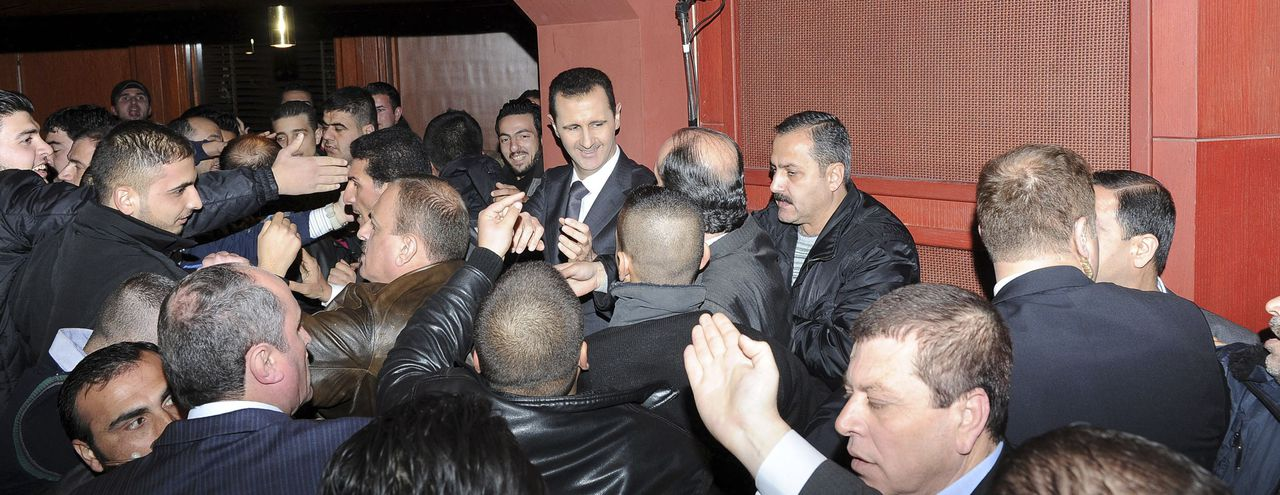 Syria's President Bashar al-Assad (C) speaks to his supporters after speaking at the Opera House in Damascus January 6, 2013, in this handout photograph released by Syria's national news agency SANA. A defiant al-Assad presented what he described as a new initiative on Sunday to end the war in Syria but his opponents dismissed it as a ploy to cling to power. REUTERS/Sana (SYRIA - Tags: POLITICS) FOR EDITORIAL USE ONLY. NOT FOR SALE FOR MARKETING OR ADVERTISING CAMPAIGNS. THIS IMAGE HAS BEEN SUPPLIED BY A THIRD PARTY. IT IS DISTRIBUTED, EXACTLY AS RECEIVED BY REUTERS, AS A SERVICE TO CLIENTS
