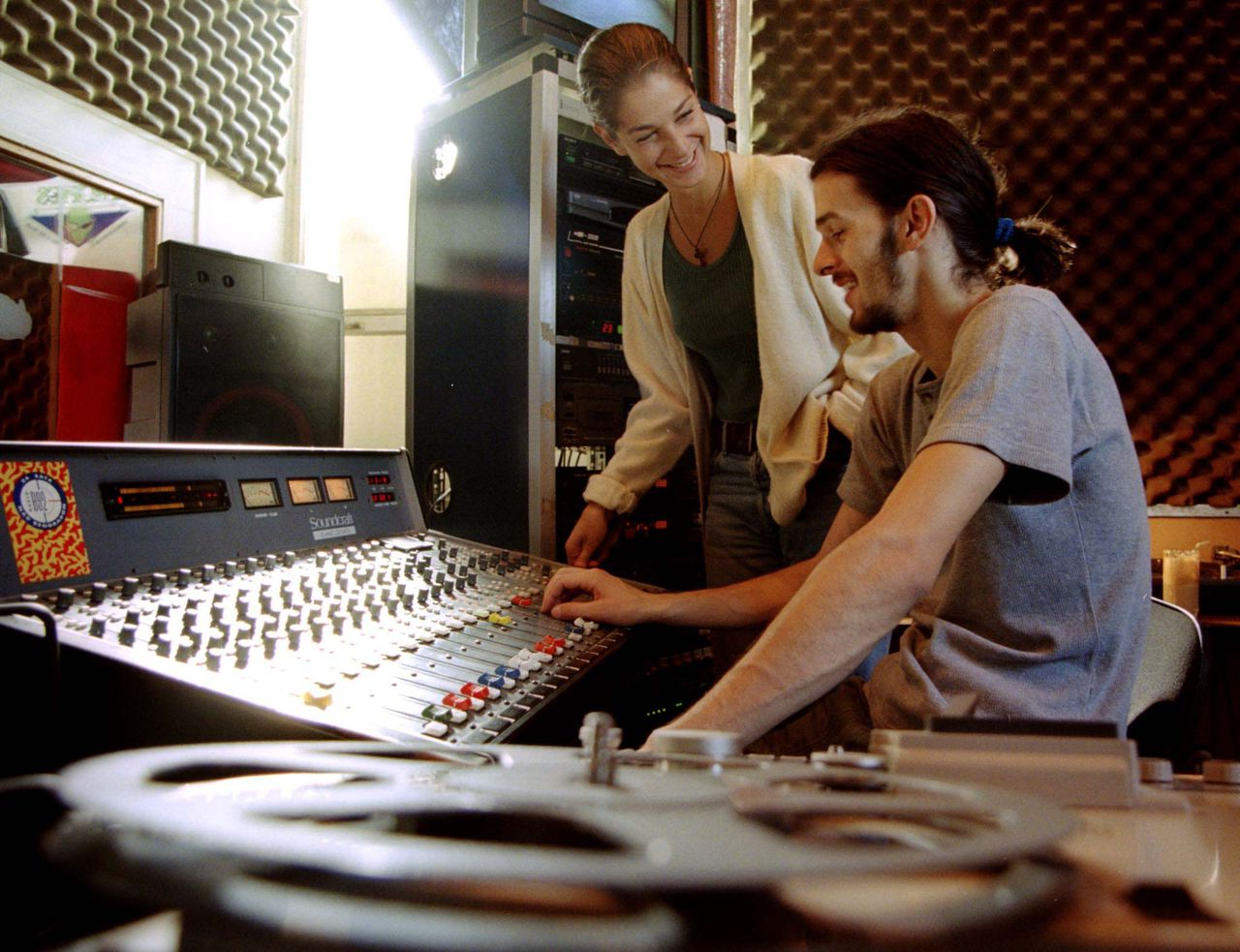 "A B92 reporter and a sound engineer work in a Belgrade studio broadcasting their radio programme October 9. Serbian Deputy Prime Minister Vojislav Seselj has banned any retransmission of foreign news services and labelled B92 as an anti-Serb radio station. He has threatened all journalists who spread defeatist reports and thus ""undermine"" the country's defence force. IM/KM"