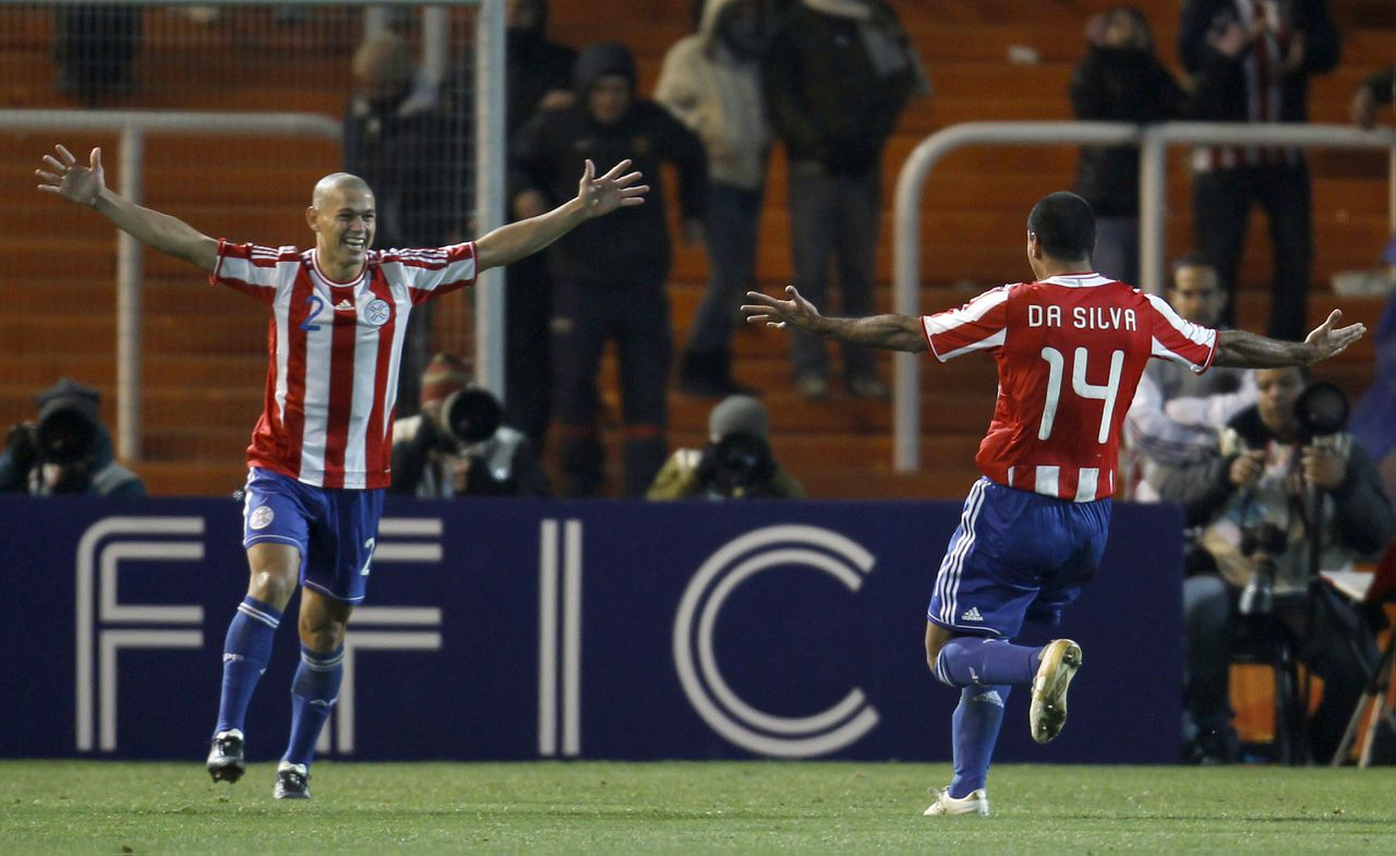 Paraguay's Dario Veron, left, celebrates with teammate Paulo Da Silva after scoring the decisive penalty kick of the penalty shootout at a Copa America semifinal soccer match in Mendoza, Argentina, Thursday, July 21, 2011. Paraguay advanced to the final against Uruguay by beating Venezuela in a penalty shootout following a goalless draw. (AP Photo/Roberto Candia)