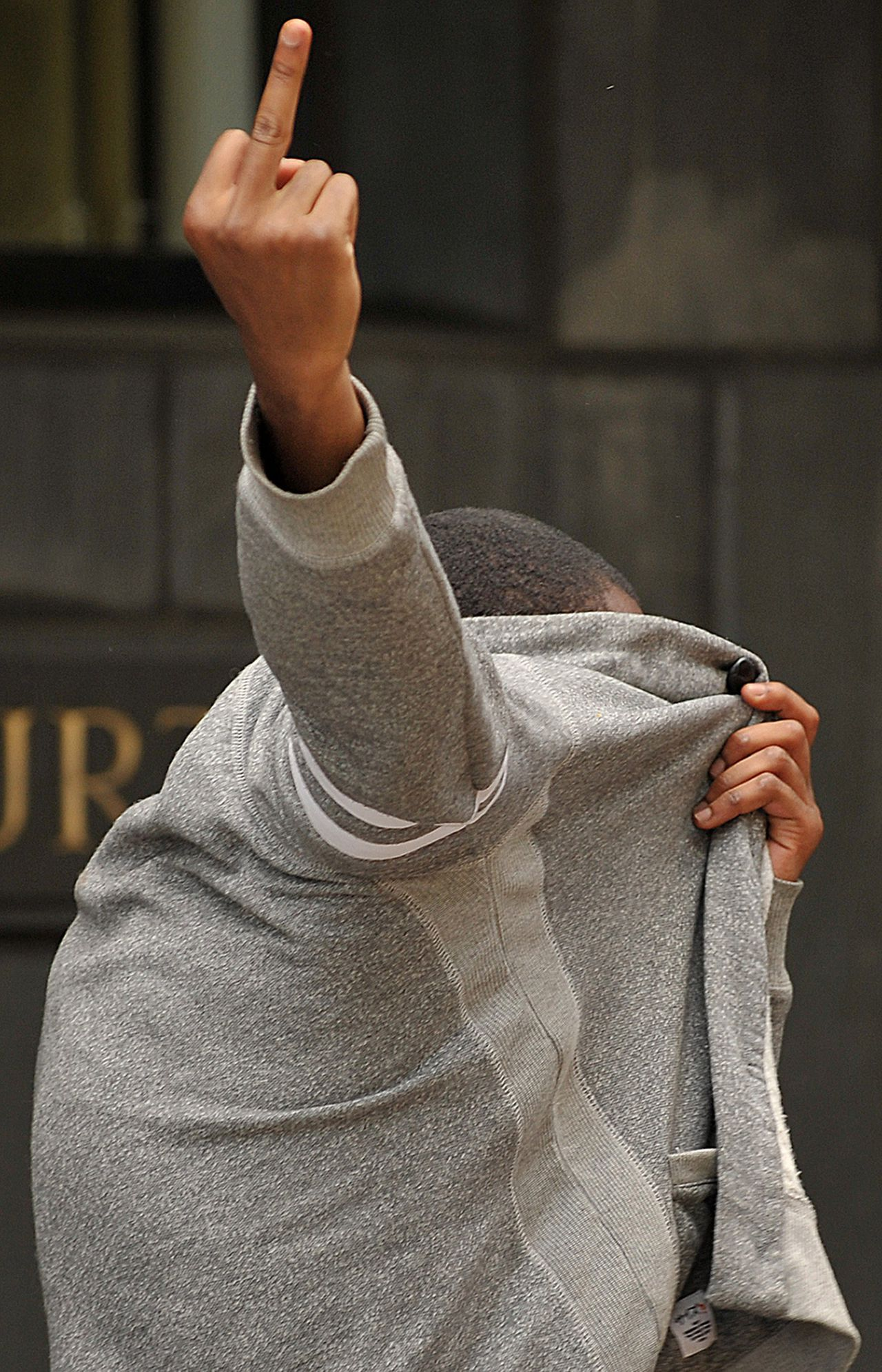 """A man believed to have taken part in a recent riot in London leaves Highbury Corner Magistrates Court in east London, on August 10, 2011. The court is one of four in London processing hundreds of people charged in connection with the recent riots in the city. Meanwhile Prime Minister David Cameron said a """"fightback"""" had begun Wednesday against Britain's worst riots in a generation, as he authorised the use of water cannon for the first time outside Northern Ireland. AFP PHOTO / BEN STANSALL"""