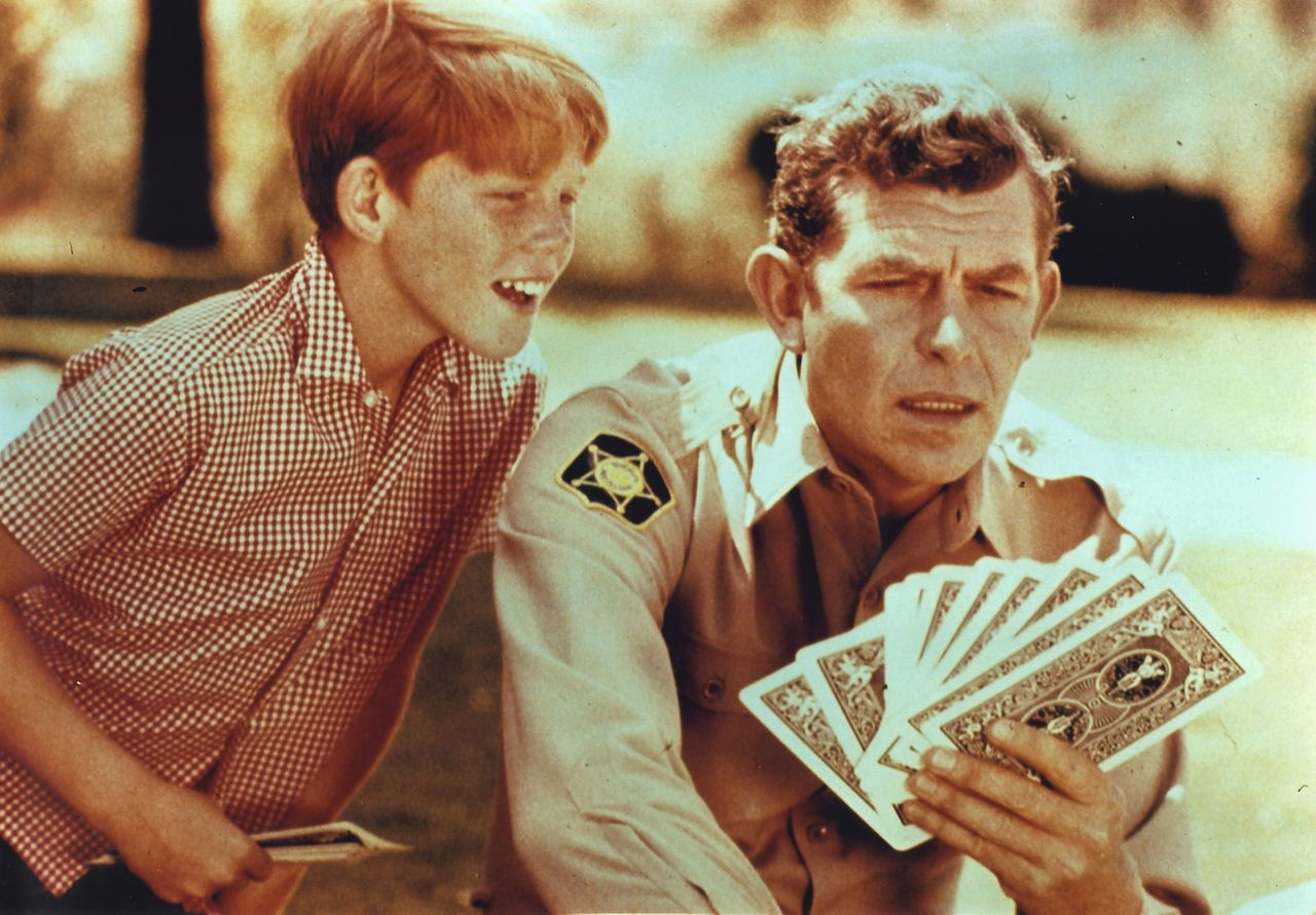 "Actors Andy Griffith (R) and Ron Howard are shown in a scene from ""The Andy Griffith Show"" in this undated publicity photograph. Griffith, whose portrayal of a small-town sheriff made ""The Andy Griffith Show"" one of television's most enduring shows, died July 3, 2012 at his North Carolina home at age 86. REUTERS/Handout (UNITED STATES - Tags: ENTERTAINMENT OBITUARY) NO SALES. NO ARCHIVES. FOR EDITORIAL USE ONLY. NOT FOR SALE FOR MARKETING OR ADVERTISING CAMPAIGNS. THIS IMAGE HAS BEEN SUPPLIED BY A THIRD PARTY. IT IS DISTRIBUTED, EXACTLY AS RECEIVED BY REUTERS, AS A SERVICE TO CLIENTS"