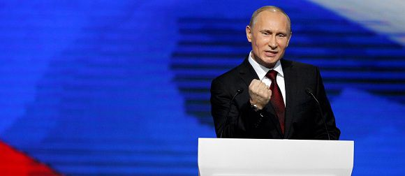 Caption: Prime Minister Vladimir Putin agestures as he speaks during a United Russia party congress in Moscow, Russia, Sunday, Nov. 27, 2011. Prime Minister Vladimir Putin has been formally nominated by the ruling United Russia party to run for president in next March's election. (AP Photo/Alexander Zemlianichenko)