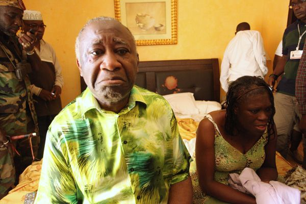 Ivory Coast's Laurent Gbagbo (L) and his wife Simone sit in a room at Hotel Golf in Abidjan, after they were arrested, April 11, 2011. Ivory Coast's Laurent Gbagbo was arrested by opposition forces on Monday after French troops closed in on the compound where the self-proclaimed president had been holed up in a bunker for the past week. Gbagbo refused to step down when Alassane Ouattara won November's presidential election, according to results certified by the United Nations, reigniting violence that has claimed more than a thousand lives and uprooted a million people. The hotel is where his rival Ouattara has his headquarters. REUTERS/Stringer (IVORY COAST - Tags: POLITICS IMAGES OF THE DAY)