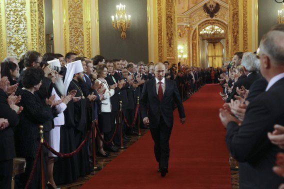 Vladimir Putin walks as he attends the inauguration ceremony at the Kremlin in Moscow May 7, 2012. Putin was sworn in as Russia's president in a glittering Kremlin ceremony on Monday, starting a six-year term in which he faces growing dissent, economic problems and bitter political rivalries. REUTERS/Vladimir Rodionov/RIA Novosti/Pool (RUSSIA - Tags: POLITICS) THIS IMAGE HAS BEEN SUPPLIED BY A THIRD PARTY. IT IS DISTRIBUTED, EXACTLY AS RECEIVED BY REUTERS, AS A SERVICE TO CLIENTS