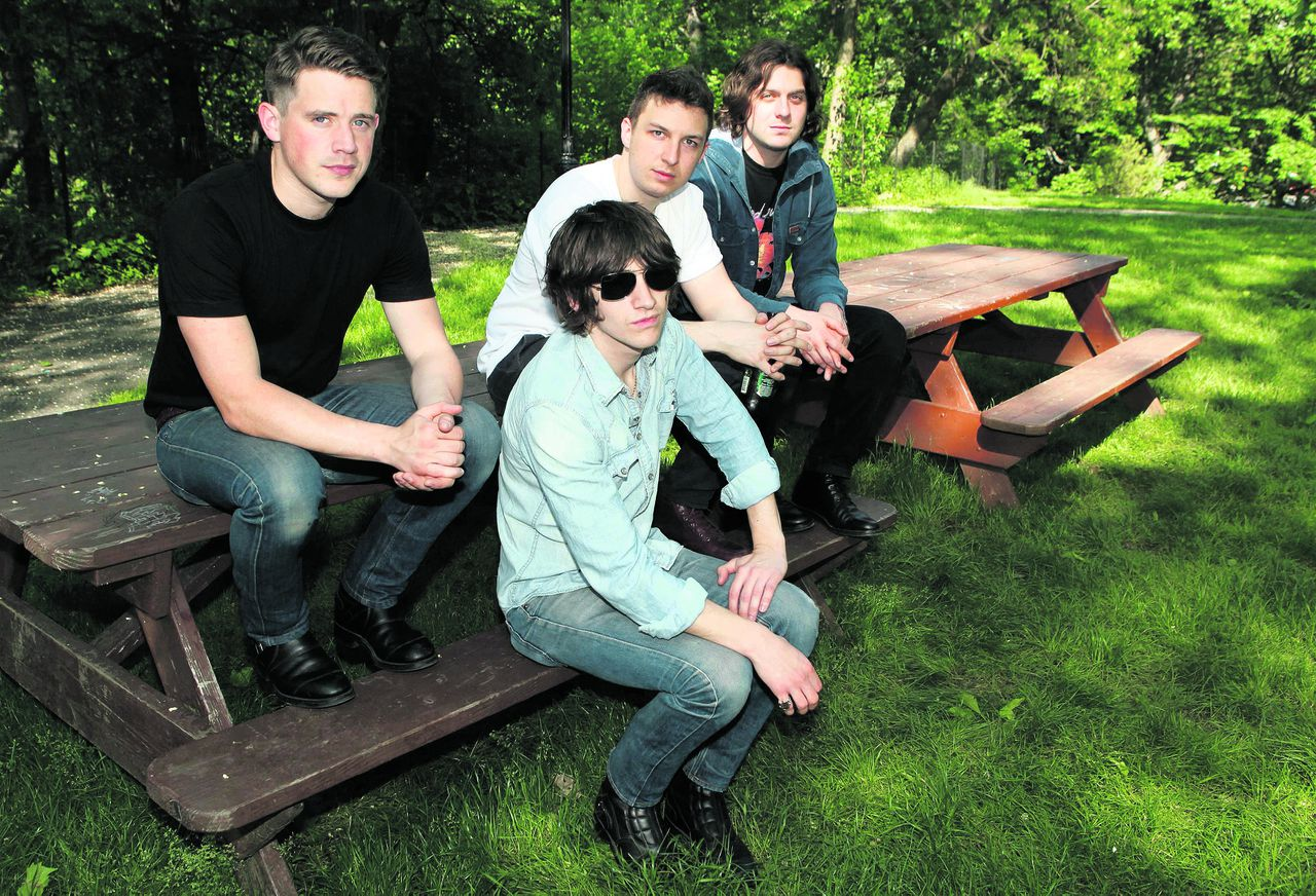 Members of the Arctic Monkeys (L-R) Nick O'Malley, Alex Turner, Matt Helders and Jamie Cook pose for a portrait in New York's Central Park May 24, 2011. REUTERS/Jessica Rinaldi (UNITED STATES - Tags: ENTERTAINMENT)