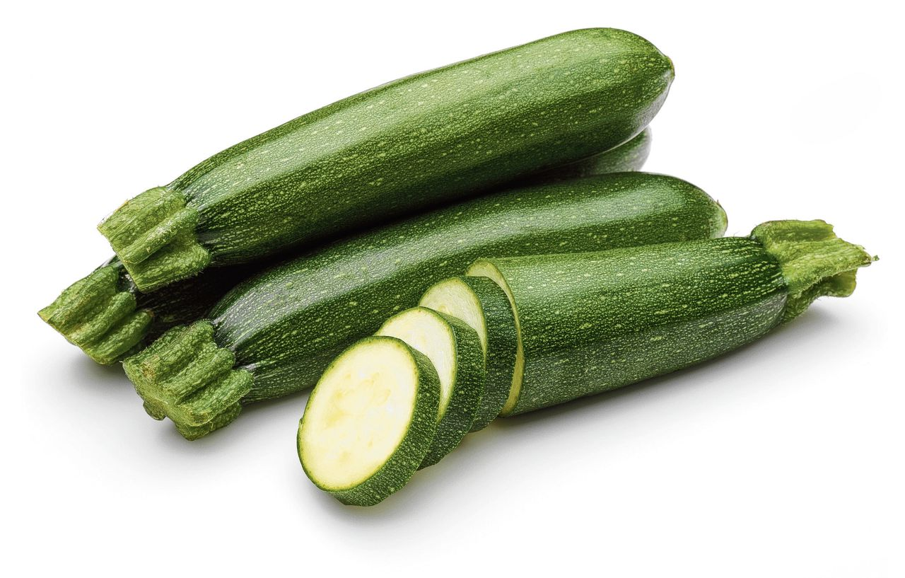 Zucchini with slices isolated on a white background