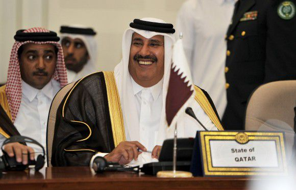 Qatari Premier and Foreign Minister Sheikh Hamad bin Jassem al-Thani smiles during a meeting of the Organisation of Islamic Conference (OIC) in the Saudi coastal city of Jeddah on November 30, 2011. Foreign ministers of the world's largest Muslim body urged Syria to cooperate with the Arab League, which imposed unprecedented sanctions on Damascus over its crackdown on months of protests. AFP PHOTO/AMER HILABI