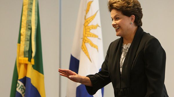 Brazilian President Dilma Rousseff (R) speaks with her Uruguayan counterpart Jose Mujica (out of frame) during a meeting at the Planalto Palace in Brasilia on January 2, 2011. Rousseff was sworn in on January 1, becoming the first female president of Brazil. AFP PHOTO/Adriano MACHADO.