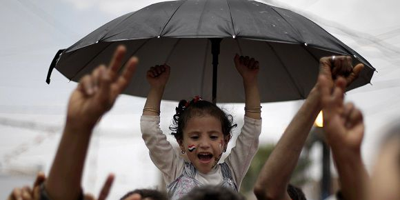 Caption: A Yemeni girl chants slogans as she participates with her father during a demonstration by anti-government protestors demanding the resignation of Yemen's President Ali Abdullah Saleh in Sanaa, Yemen, Saturday, Sept. 3, 2011.(AP Photo/Hani Mohammed)