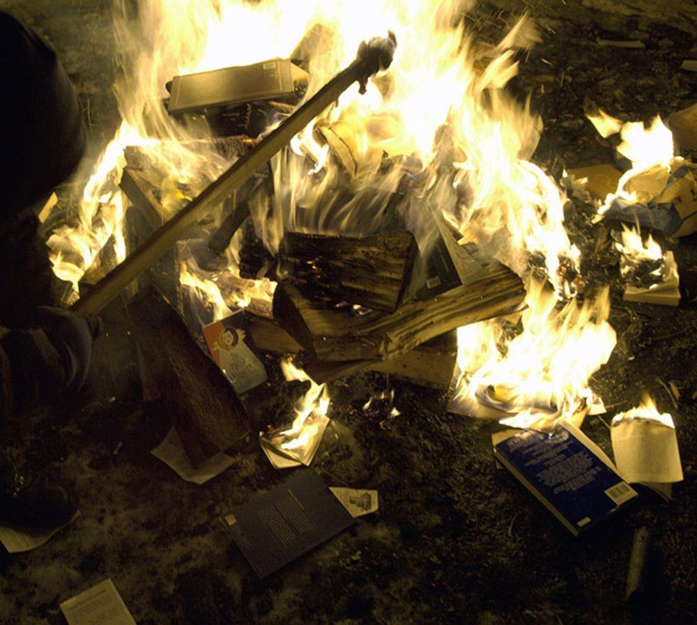 National Socialist Movement holds a book burning. St Paul, Minnesota. January 27, 2007. The National Socialist Movement, along with members of the Aryan Nations and various Skinhead groups, gathered for a book burning. The burning is said to be the first since 1933, when the Nazi's put 1000's of Jewish books to flames. Nearly 100 men and women assembled around the three-foot pyre. Speeches were made in reference to the historical importance of the event, as letters from the German Government telling the NSM how music from their record label is banned from Germany were tossed into the flames. Soon to follow was an Israeli flag, copies of the Talmud, various books promoting homosexuality and books supporting Israel. The event culminated with a concert and taping of a video for the NSM band Total War, at another location. According to the NSM, the Talmud was burned because it makes statements that: only Jews are human... a Gentile girl of three years can be violated... a Jew is permitted to rape, cheat and perjure himself... and that a Jew may not give fair evidence in a court against another Jew. **No Tabloids, Special Conditions Apply** boekverbranding