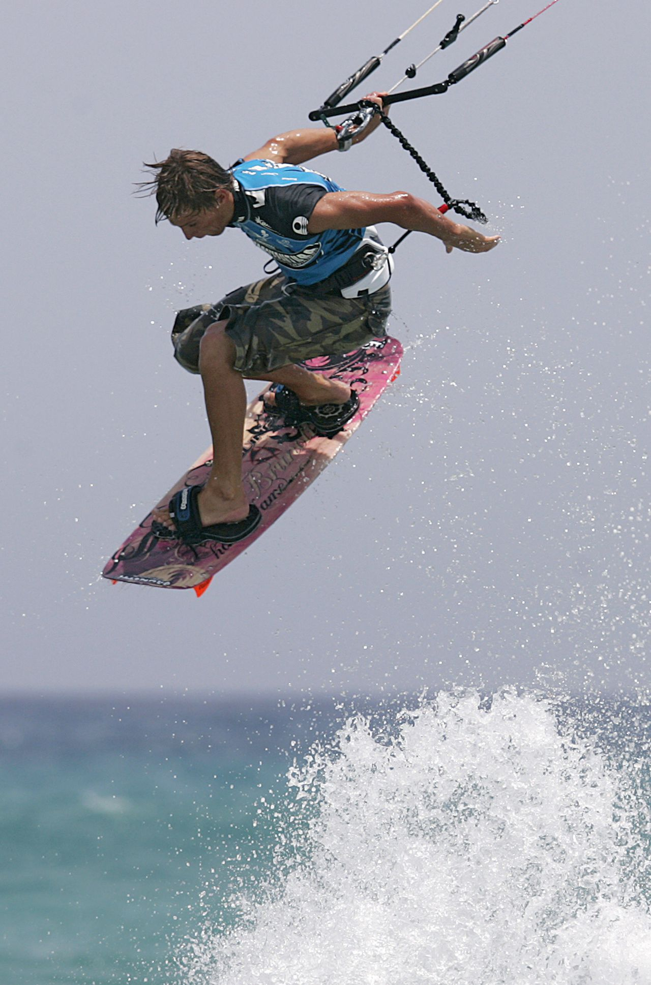 Youri Zoon of Netherlands goes airborne while competing in the freestyle event of the PKRA Kiteboarding Grand Prix in the Spain's Canary Island of Fuerteventura, August 3, 2006. REUTERS/Juan Medina (SPAIN)