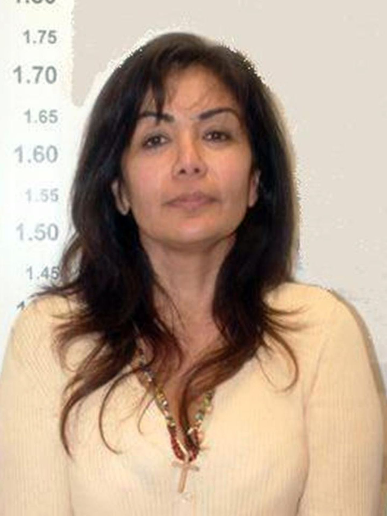 """In this photo released by Mexico's Federal Secretary of Public Safety, Sandra Avila Beltran, also known as the """"Queen of the Pacific,"""" smiles for a police mug shot on the day of her arrest in Mexico City, Sept. 28, 2007. The raven-haired 46-year-old worked her way to the top of Mexico's male-dominated illegal drug industry, prompting U.S. officials to issue a warrant for her arrest.(AP Photo/Mexico's Federal Secretary of Public Safety) ** NO SALES ** NO ARCHIVE **"""
