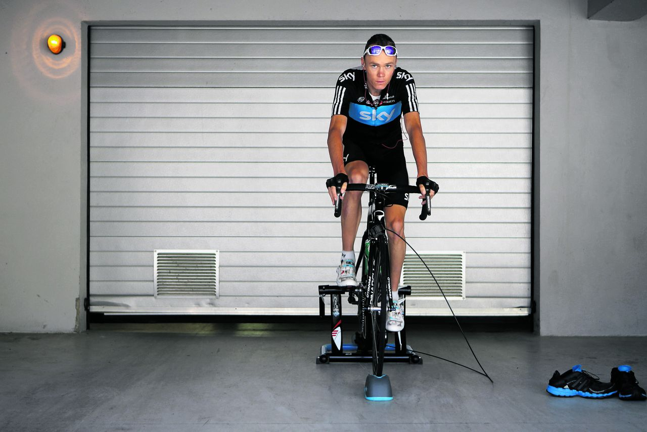 The garage door opens while Christopher Froome of Britain warms up prior to leaving for a training ride on the rest day of the Tour de France cycling race in Pau, France, Tuesday July 17, 2012. (AP Photo/Laurent Cipriani)
