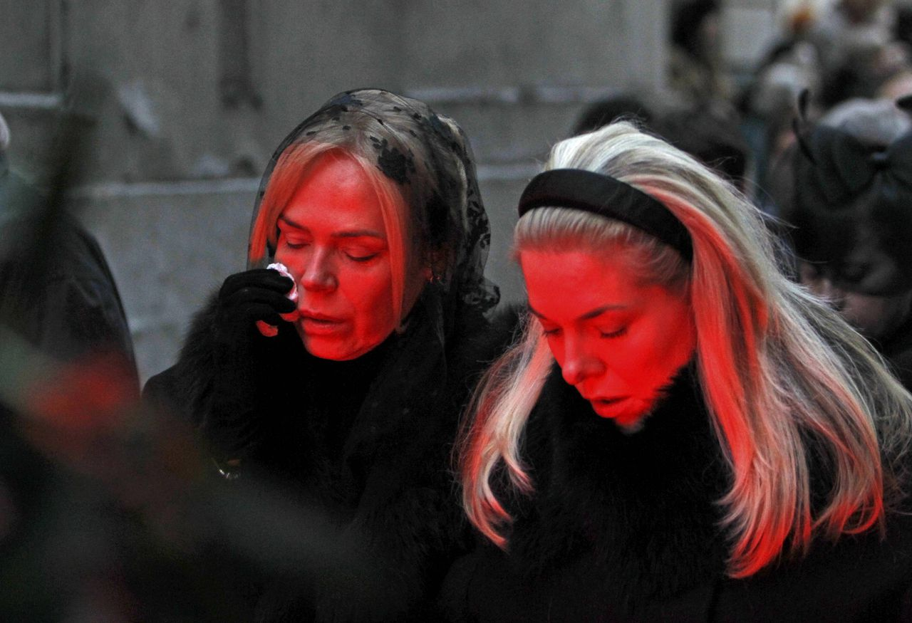"The wife of late former Czech President Vaclav Havel, Dagmar (L) cries next to her daughter Nina (R) as she walks after a hearse transporting Havel's body to Prague Castle for the funeral ceremony in Prague December 21, 2011. Havel, the playwright-turned-president whose ""Velvet Revolution"" toppled Communist rule, died on Sunday at his country home in Hradecek, northeast of Prague, after a long respiratory illness. REUTERS/David W Cerny (CZECH REPUBLIC - Tags: POLITICS OBITUARY TPX IMAGES OF THE DAY)"