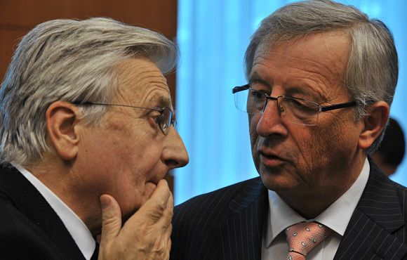 Caption: European Central Bank President Jean-Claude Trichet and Luxembourg Prime Minister and Eurogroup head Jean-Claude Juncker talk prior a Eurogroup Council meeting on June 14, 2011 at EU headquarters in Brussels. Eurozone finance ministers are meeting in Brussels bidding to resolve a damaging row over the extent to which banks and other private investors can be forced to contribute to a second Greece bailout. German Finance Minister Wolfgang Schaeuble said on June 14 that Berlin was ready to give Greece more financial aid under a second eurozone-IMF bailout -- provided banks and other private creditors take part.