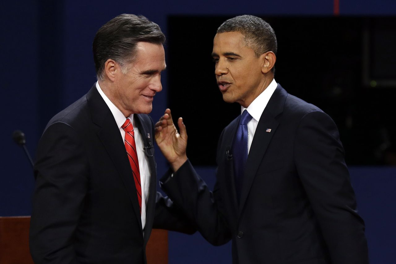 FILE - In this Oct. 3, 2012, file photo, Republican presidential candidate former Massachusetts Gov. Mitt Romney and President Barack Obama talk after the first presidential debate at the University of Denver in Denver. In 2008, Obama used Colorado as a stage both for his nominating convention and to show how his new brand of politics could unite young voters, women and minorities to create a winning coalition even in places that normally back Republican presidential candidates. Now Colorado has become an example of how hard it has been for Obama to maintain that coalition against the headwinds of a sour economy and his disastrous debate performance in Denver. (AP Photo/Charlie Neibergall, File)