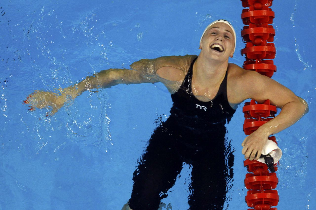 Denmark's Jeanette Ottesen laughs after winning the women's 100m freestyle final at the 14th FINA World Championships in Shanghai July 29, 2011. REUTERS/Carlos Barria (CHINA - Tags: SPORT SWIMMING AQUATICS)