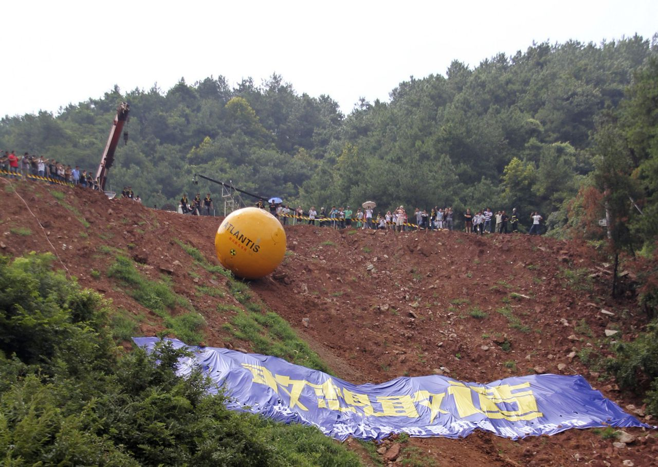 Noah's Ark of China, a six-ton (5,443 kg) ball container built by Chinese inventor Yang Zongfu, undergoes a rolling test in Yiwu, Zhejiang province, August 6, 2012. According to local media, Yang spent two years and 1.5 million RMB (235,585 USD) to build this four-metre diameter vessel, which has been tested capable of housing a three-person family and sufficient food for them to live in 10 months. The vessel was designed to protect people inside from external heat, water and external impact. Picture taken August 6, 2012. REUTERS/China Daily (CHINA - Tags: SOCIETY SCIENCE TECHNOLOGY) CHINA OUT. NO COMMERCIAL OR EDITORIAL SALES IN CHINA