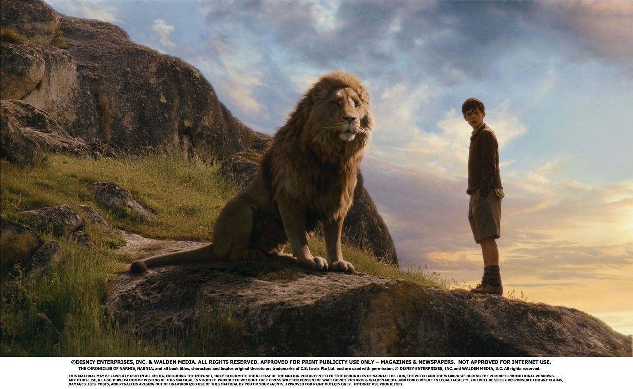 """Pictured: Edmund (SKANDAR KEYNES, right) comes face to face with Aslan in a scene from THE CHRONICLES OF NARNIA: THE LION, THE WITCH AND THE WARDROBE, directed by Andrew Adamson. Distributed by Buena Vista International. THIS MATERIAL MAY BE LAWFULLY USED IN MEDIA ONLY TO PROMOTE THE RELEASE OF THE MOTION PICTURE ENTITLED """"THE CHRONICLES OF NARNIA: THE LION, THE WITCH AND THE WARDROBE"""" DURING THE PICTURE'S PROMOTIONAL WINDOWS. ANY OTHER USE, RE-USE, DUPLICATION OR POSTING OF THIS MATERIAL IS STRICTLY PROHIBITED WITHOUT THE EXPRESS WRITTEN CONSENT OF WALT DISNEY PICTURES & WALDEN MEIDA. AND COULD RESULT IN LEGAL LIABILITY. YOU WILL BE SOLELY RESPONSIBLE FOR ANY CLAIMS, DAMAGES, FEES, COSTS, AND PENALTIES ARISING OUT OF UNAUTHORIZED USE OF THIS MATERIAL BY YOU OR YOUR AGENTS. THE CHRONICLES OF NARNIA, NARNIA, and all book titles, characters and locales original thereto are trademarks of C.S. Lewis Pte Ltd. and are used with permission. © DISNEY ENTERPRISES, INC. and WALDEN MEDIA, LLC. All rights reserved. NOT APPROVED FOR INTERNET USE. APPROVED FOR PRINT OUTLETS ONLY."""