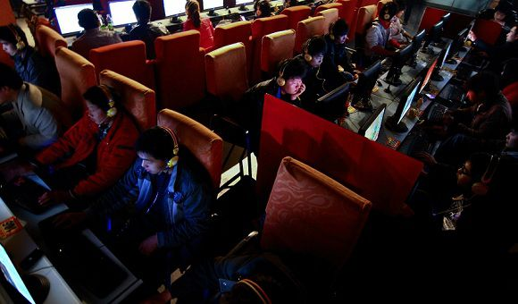 Caption: In this photo taken on Friday, March 12, 2010, people use computers at an Internet cafe in Fuyang, in central China's Anhui province. Chinese Internet users are being targeted for their budding grass-roots activism _ ordinary people spreading the word about grievances from every corner of the country with postings on Twitter, microblogs and other Web sites. (AP Photo) ** CHINA OUT **