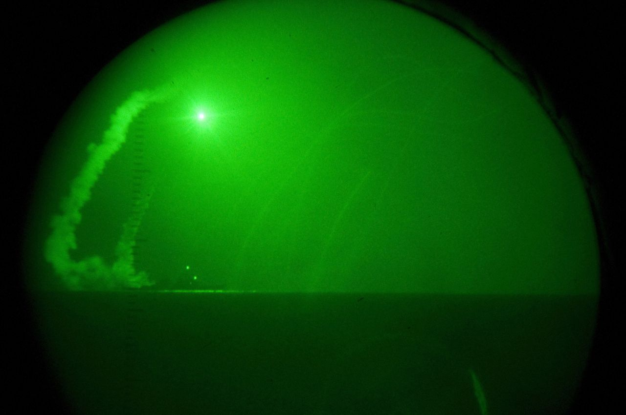 CORRECTION-CAPTION BYLINE == MANDATORY CREDIT TO US NAVY VISUAL NEWS SERVICE == In this image released by the US Navy Visual News Service March 19, 2011 shows a view seen through night-vision lenses aboard amphibious transport dock USS Ponce (LPD 15), the guided missile destroyer USS Barry (DDG 52) fires Tomahawk cruise missiles in support of Operation Odyssey Dawn, in Mediterranean Sea on March 19, 2011. This was one of approximately 110 cruise missiles fired from U.S. and British ships and submarines that targeted about 20 radar and anti-aircraft sites along LibyaÕs Mediterranean coast. Joint Task Force Odyssey Dawn is the U.S. Africa Command task force established to provide operational and tactical command and control of U.S. military forces supporting the international response to the unrest in Libya and enforcement of United Nations Security Council Resolution (UNSCR) 1973. AFP PHOTO / US NAVY VISUAL NEWS SERVICE / Mass Communication Specialist 1st Class Nathanael Miller / HANDOUT == RESTRICTED TO EDITORIAL USE - NOT FOR SALE FOR MARKETING OR ADVERTISING CAMPAIGN - DISTRIBUTED AS A SERVICE TO CLIENTS ==