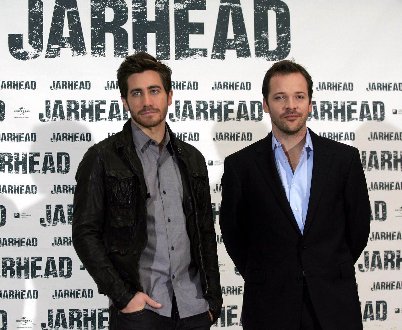 """US actors Jake Gyllenhaal, left, and Peter Sarsgaard, right, pose for the photographers in Berlin Monday, Dec. 12, 2005, during a photocall for their anti-war-film """"Jarhead"""". (AP Photo/Roberto Pfeil)"""