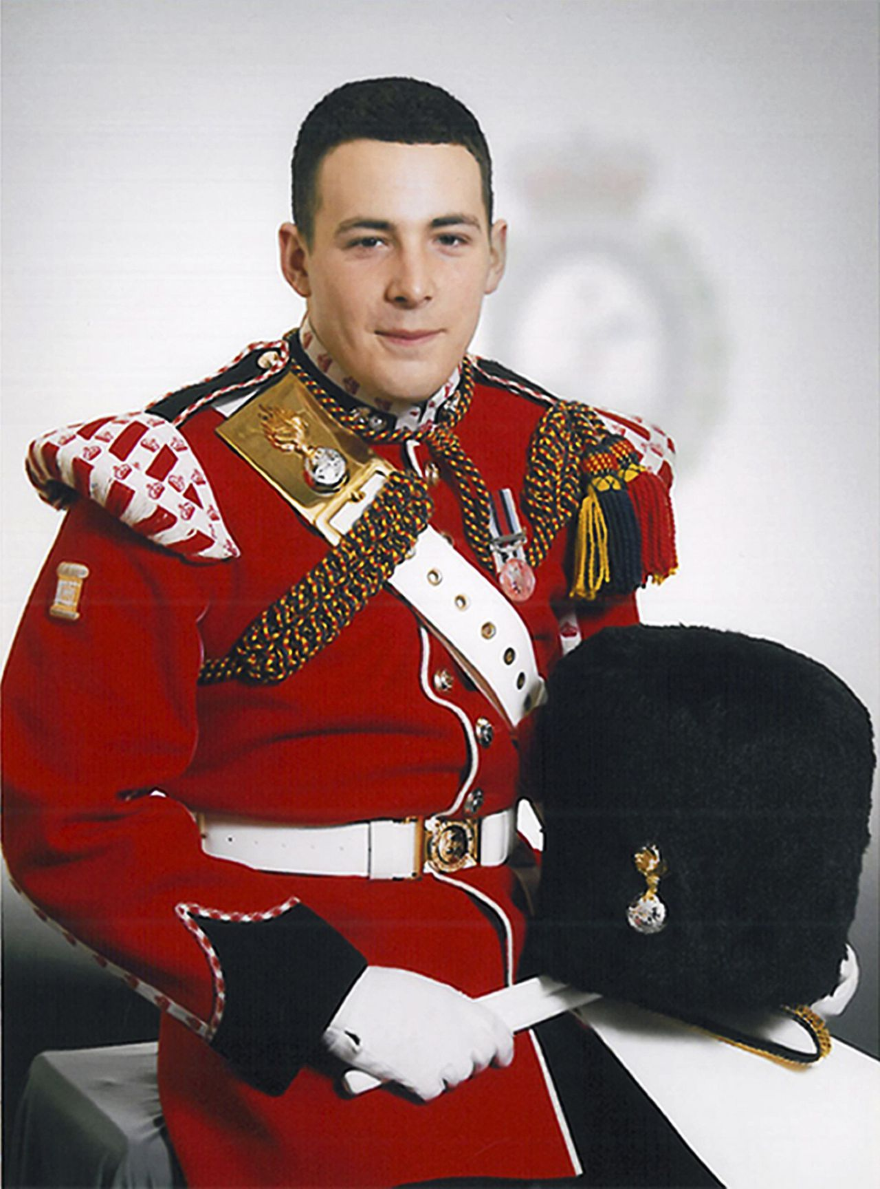 ATTENTION EDITORS - QUALITY REPEAT Drummer Lee Rigby, of the British Army's 2nd Battalion The Royal Regiment of Fusiliers, is seen in an undated photo released May 23, 2013. Rigby was killed May 22 in an attack by two men in Woolwich, southeast London, the Ministry of Defence said on Thursday. REUTERS/Ministry of Defence/Crown Copyright/Handout (BRITAIN - Tags: MILITARY OBITUARY CIVIL UNREST CRIME LAW TPX IMAGES OF THE DAY) ATTENTION EDITORS - THIS IMAGE WAS PROVIDED BY A THIRD PARTY. FOR EDITORIAL USE ONLY. NOT FOR SALE FOR MARKETING OR ADVERTISING CAMPAIGNS. THIS PICTURE IS DISTRIBUTED EXACTLY AS RECEIVED BY REUTERS, AS A SERVICE TO CLIENTS