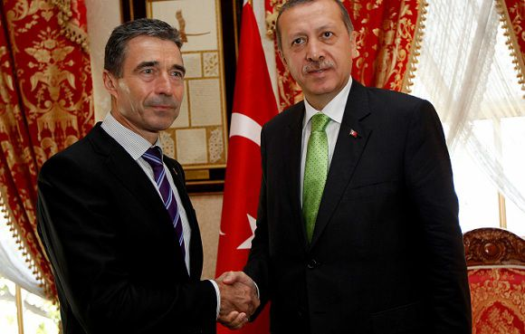Caption: NATO Secretary General Anders Fogh Rasmussen (L) shakes hands with Turkey's Prime Minister Tayyip Erdogan before their meeting in Istanbul July 15, 2011. Western and Arab powers began talks in Turkey on Friday aimed at finding a political solution for Libya that would persuade Muammar Gaddafi to give up power and end a conflict that could otherwise drag on interminably. REUTERS/Murad Sezer (TURKEY - Tags: POLITICS)