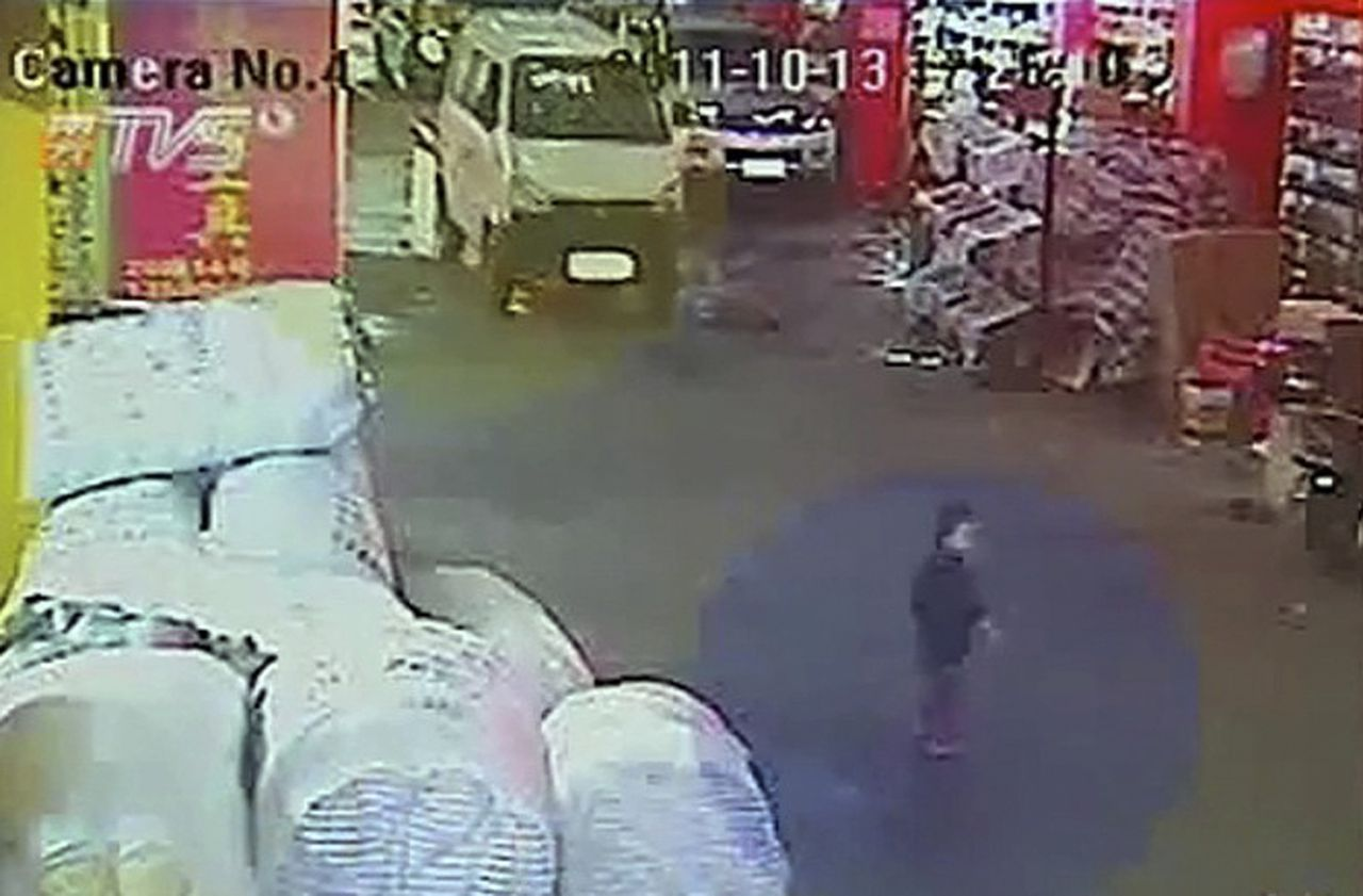 In this image taken from Oct. 13, 2011 security camera video run by China's TVS, a 2-year-old girl, identified as Wang Yue, is seen just before she is hit by a white van seen in the background in Foshan in southern China's Guangdong province. The video showing a toddler being struck twice by vans and then ignored by passers-by is sparking outrage in China and prompting soul-searching over why people didn't help the child. (AP Photo/TVS via APTN) CHINA OUT, NO SALES, NO ARCHIVES, EDITORIAL USE ONLY