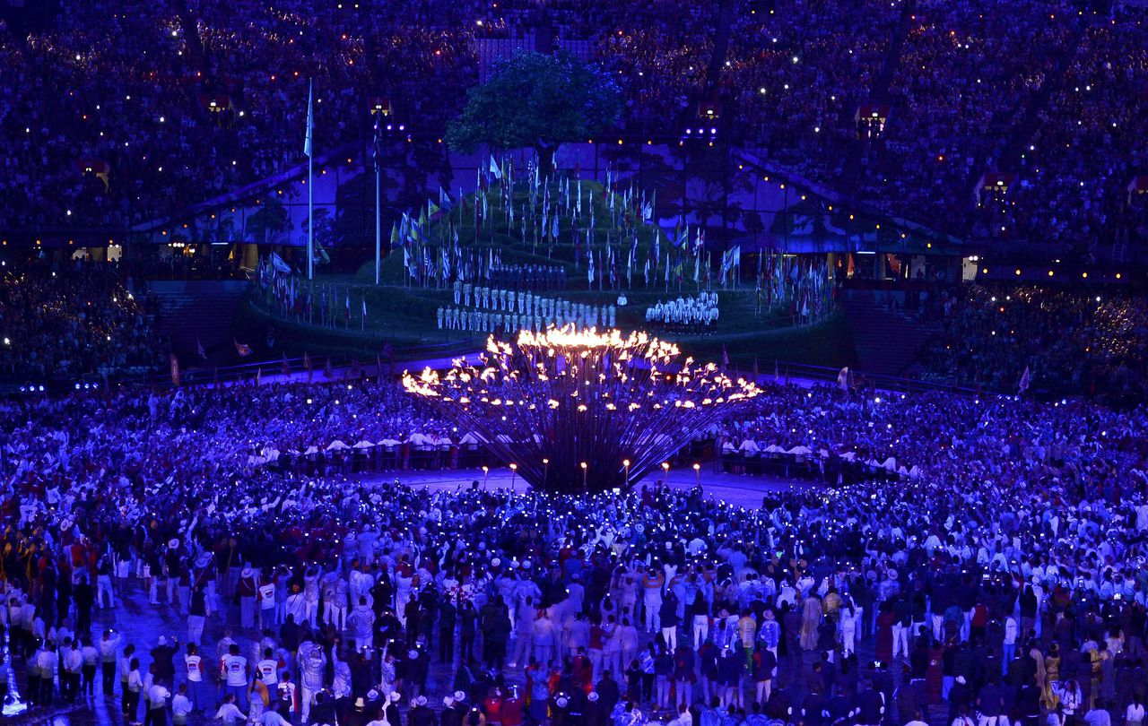 The Olympic Flame is lit during the opening ceremony of the London 2012 Olympic Games at the Olympic Stadium July 27, 2012. REUTERS/Dylan Martinez (BRITAIN - Tags: SPORT OLYMPICS)