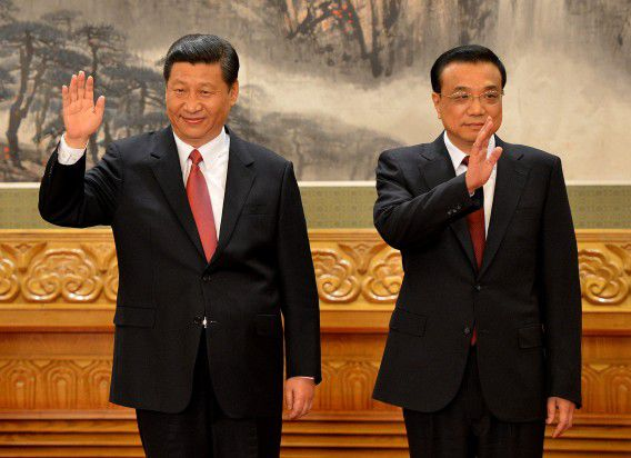 Chinese Vice president Xi Jinping (L) and Li Keqiang (R) as Xi emerges as the head of the newly reshuffled seven member Communist Party of China Politburo Standing Committee, the nation's top decision making body at the Great Hall of the People in Beijing on November 15, 2012. Xi Jinping was appointed China's new leader at the helm of a revamped top power circle that will face the tricky task of setting the planet's second-largest economy on a new course. AFP PHOTO/Mark RALSTON