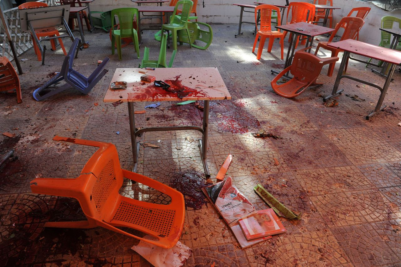 "A handout picture released by the Syrian Arab News Agency (SANA) shows blood on tables and on the floor in the cafeteria of the architecture faculty of Damascus University afer it was hit by a mortar attack on March 28, 2013 in Syria. Shelling killed at least 15 students, with state media blaming ""terrorists"" -- its term for Syrian rebels increasingly targeting President Bashar al-Assad's seat of power. AFP PHOTO/HO/SANA == RESTRICTED TO EDITORIAL USE - MANDATORY CREDIT ""AFP PHOTO / HO / SANA"" - NO MARKETING NO ADVERTISING CAMPAIGNS - DISTRIBUTED AS A SERVICE TO CLIENTS =="