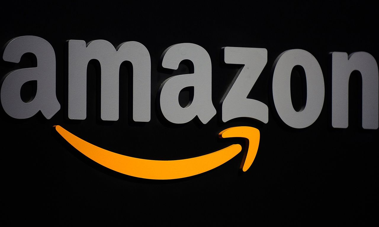 (FILES) This September 28, 2011 file photo shows the Amazon logo on a podium during a press conference in New York. Amazon on October 27, 2014 unveiled a new media stick allowing users to stream content to television sets, challenging Google's Chromecast device released last year. The plug-in Fire TV Stick, a device the size of a pack of gum, provides access to Amazon Instant Video as well as other services including Netflix, Hulu Plus, WatchESPN and NBA Game Time. The dongle is being sold in the US market for $39, or $19 for customers who subscribe to Amazon Prime, which gives customers free shipping and access to music, videos and other online content. AFP PHOTO/Emmanuel Dunand / FILES