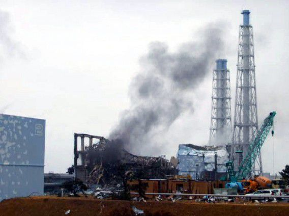 """---EDITORS NOTE---HANDOUT RESTRICTED TO EDITORIAL USE - MANDATORY CREDIT """"AFP PHOTO / TEPCO"""" - NO MARKETING NO ADVERTISING CAMPAIGNS - DISTRIBUTED AS A SERVICE TO CLIENTS (FILES) This handout file picture released from Tokyo Electric Power Co (TEPCO) on March 21, 2011 shows black smoke rasing from the third reactor building of TEPCO's Fukushima Dai-ichi nuclear power plant at Okuma town in Fukushima prefecture. Japan looked set to announce it had finally tamed leaking atomic reactors at the Fukushima Dai-ichi power station on December 16, 2011, nine months after one of the world's worst nuclear crises began. AFP PHOTO / TEPCO / HO / FILES"""