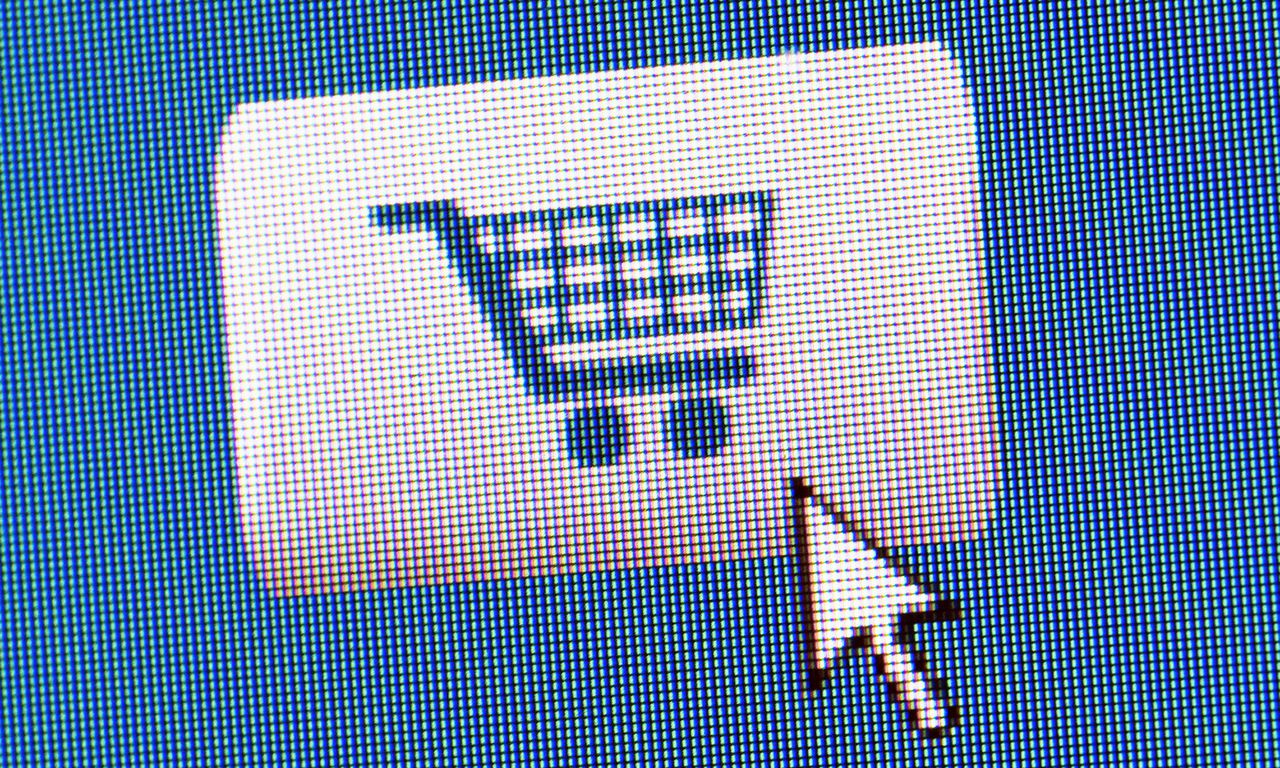 Screen shot of Add to cart button for online shopping --- Image by © Tetra Images/Corbis