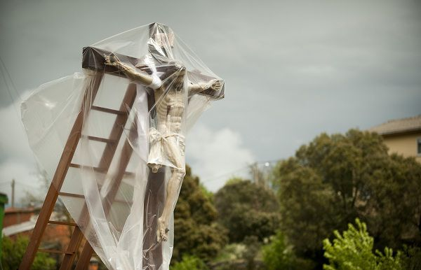 A statue of Jesus Christ is covered with a plastic sheet to protect it from the rain during the Good Friday procession in the Northwestern Spanish village of Bercianos de Aliste, near Zamora, during the Holy Week, on April 22, 2011. AFP PHOTO / RAFA RIVAS
