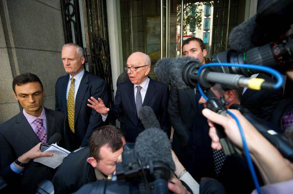 Rupert Murdoch speaks outside a hotel where he met the familly of murdered teenager Milly Dowler in central London July 15, 2011. News Corp Chief Executive Rupert Murdoch said sorry on Friday to victims of phone hacking at one of his British tabloids after confidante Rebekah Brooks quit as head of the media empire's British newspaper arm. The twin steps were designed to quell an escalating scandal that has forced Murdoch to close the News of the World newspaper and drop a $12 billion plan to buy full control of pay TV operator BSkyB. REUTERS/Paul Hackett (BRITAIN - Tags: BUSINESS POLITICS MEDIA)